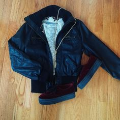 Black Faux Leather Bomber Jacket Black faux leather bomber jacket with cheetah print lining. It's very comfortable and warm. Size M, I fold the sleeves a little bit since it's a bit too long for me. Great condition. Price is negotiable, make me an offer  Jackets & Coats