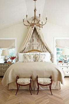 A draped canopy adds pattern and texture to the neutral bedroom. - Traditional Home ® / Photo: Werner Straube / Design: Samantha Lyman