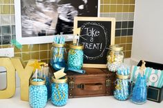 Nautical baby shower: Enlarge an ultrasound photo by requesting an architect print or blueprint size photo at Office Depot. Use mason jars filled with various candies as goodie bags guests can help themselves to! #letscelebrate