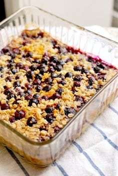 Baked Oatmeal with Lemon and Blueberries    2 1/2 cups old-fashioned rolled oats  1 teaspoon baking powder  1/2 – 1 teaspoon kosher salt  zest of 1 lemon  1/2 teaspoon nutmeg  2 tablespoons butter, melted and cooled  2 cups milk  1 egg  1/2 cup sugar  2 cups blueberries, fresh or frozen