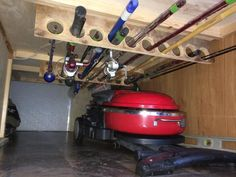 """Needed a place to keep the fishing poles up out of the way along with the broom and awning rod. Cut 2"""" diameter holes in two boards that were 6"""" wide and secured them in the front hold under the front bunks."""