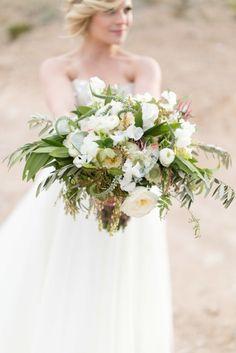 Plush #bouquet with ranunculus and eucalyptus.   Photography: Kristen Joy Photography - www.kristenjoyphoto.com Photography: J. Anne Photography - www.j-annephotography.com