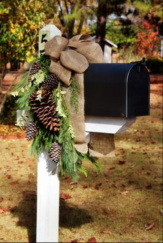 An average mailbox gets a seasonal makeover with some evergreen branches, pine cones and a burlap bow.