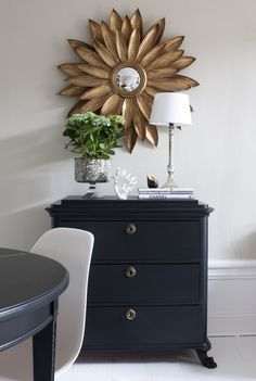 Gorgeous, gold flower mirror mixed with silver candlestick table lamp and brass drawer hardware. See? You can mix metals!