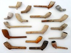 17 clay pipes all found in one spot. Some have numbers and letters written on them. It looks like someone didn't want their collection any more.