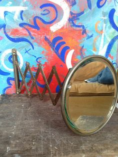 This is a beautiful antique shaving mirror. The mirror is in great shape with only a few tiny tiny scratches. The bracket and extendable arm are in working order and hold the mirrors position where you want. I made no attempt to clean this mirror because I like to show its true age but if you wish to do so Im sure you can bring it back with very little effort. Mirror measures 8 inches in diameter, when full extended reaches out to 27 inches.  Please feel free to ask any questions. Thanks for…