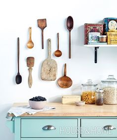 It doesn't have to be fancy — that's the whole point of summer style. This collection of flea market spoons were picked up on the way to cottage country and not only serve as souvenirs of life at the lake, but add interest to walls. Get more ideas for relaxed summer style at houseandhome.com. [Design: @kaiethier and @jenniferkoper | Photo: Kim Jeffery] #houseandhome #hhstyle #design #summerstyle #interiordesign #homedesign #kitchen #kitchendesign #designinspiration