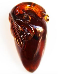 "Burmite (Burmese Amber) Carving - Amber from Burma is much older than other amber and much harder and takes a higher polish - 32.25 ct - 1.50"" (38.20 mm) x 0.82"" (20.90 mm) x 0.78"" (19.90 mm)"