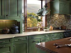 cream countertop, green cabinets. Changed again...this feeling. Grey stone countertop, green cabinet, glass backsplash.
