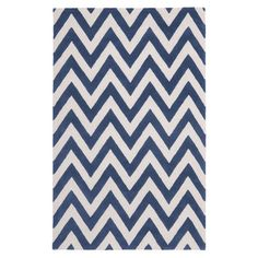 Make a statement in your home with this hand-tufted wool rug, showcasing a chic chevron design in navy and ivory tones. Use it to define areas in your lounge...