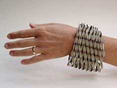 Nel Linssen, bracelet, polycarbonate on paper, polyester thread