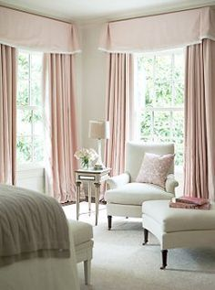 Guest bedroom - shell pink accents and cozy seating area