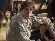 New 'Outlander' Still & Wallpaper! Jamie Fraser Shows a Little Inner Thigh in Castle Leoch Stables.
