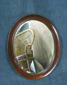 Beautiful antique mahogany framed oval mirror, gadrooned outer edge with beaded inner.  Excellent condition for age.  Complete with hanging wire to back.  Measures 60 cm X 50 cm