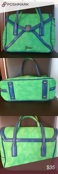 Guess alligator embossed satchel Unique bright green and blue satchel with a scale print embossed through out. This is the bag that is going to make the right outfit. Side zip inside pocket, detachable adjustable shoulder strap. Great condition, no makeup residue or other stains. Guess Bags Satchels