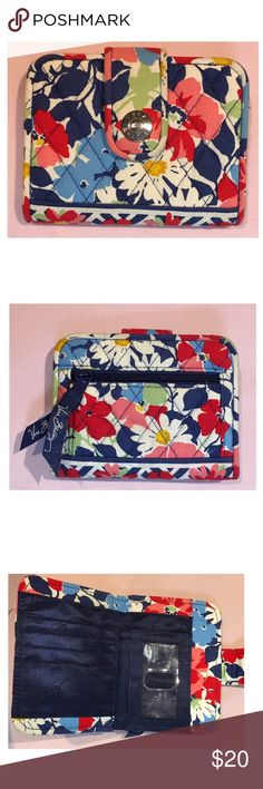 Vera Bradley Wallet Cute Vera Bradley purse/wallet with two pockets for cash, 4 for cards, one clear covered pocket for an ID, and a zipped pocket for coins. Used but in good condition. Comment with any questions! Price isn't firm! Vera Bradley Bags Wallets