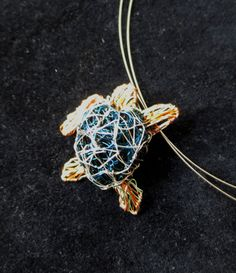#Seaturtle #necklace #Turtlejewelry #Uniquenecklacesforwomen #Wiresculpture #artnecklace #Wireartjewelry #Oceanjewelry #Seajewelry  This is a wire sculpture art sea turtle necklace. The unique wire art necklace for women, made of colored copper wire and silver. The height of the ocean turtle necklace jewelry is 3.5cm (1.38in).The sea turtle unique jewelry hanging from steel wire and the clip is silver.