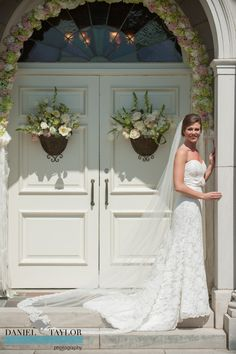 A bridal portrait in front of the floral arch at Samford University's Reid Chapel. Daniel Taylor Photography. Florals by Kathy Miller.