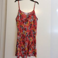 FINAL SALE Floral romper Pretty floral romper with drawstring and side pockets.  NWOT Dresses