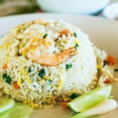 Shrimp Fried Rice - shrimp - rice wine - fresh ginger - sesame oil - chicken broth - soy sauce -  olive oil - 2 large eggs - scallions - frozen peas - rice