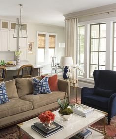 Hallie Henley Design - living rooms - Brielle Coffee Table, open plan living, camel sofa, camel colored sofa, greek key pillows, navy greek key pillows, persimmon pillow, brass end table,