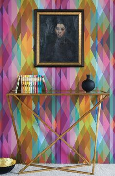 Prism Wallpaper An impressive wallpaper featuring overlapping harlequins in kaleidoscopic shards of pink, orange, purple, green and blue to create a real signature piece for the interior. Prism takes inspiration from the very successful Circus design from the first Geometric collection but is much smaller in scale and printed with a brighter palette.