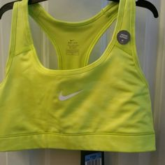Nike Sports Bra Size Medium Bright yellow sports bra with a darker yellow design.  It's hard to get a great picture of it but it's super cool Nike Intimates & Sleepwear Bras