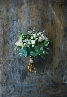 Beautiful bouquet if more in deep red/dusk pink. Love the style, eucalyptus, protea, gum nuts, and small flowers (wax flowers? Small Wedding Bouquets, Small Bouquet, Wedding Flower Arrangements, Bride Bouquets, Flower Bouquet Wedding, Floral Bouquets, Floral Wedding, Green Bouquets, Floral Arrangement