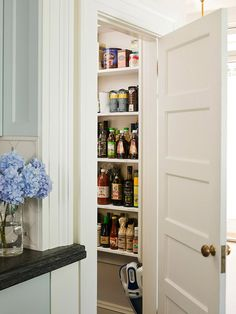 Great Kitchen Storage Ideas - Traditional Home®. Slide of Squeeze a pantry into a narrow closet or wall space at the top of basement stairs. Narrow shelves make items easy to spot. Kitchen Sink Storage, Kitchen Pantry Cabinets, Narrow Closet, Closet Small, Vanity Shelves, Closet Shelves, Bathroom Shelves, Pantry Shelving, Pantry Closet