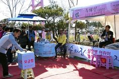 Taean, South Korea - April 22, 2017: Duet singer 'Su and Jin' is doing a charity performance to help children with heart disease in Taean world tulip festival