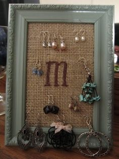 Earring holder - I so made this, but I put pillow stuffing behind the burlap!