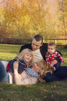 Fun fall family of four pictures, cute pose by ShaiLynn Photography