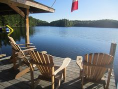 Why Canadian suffers through months of winter - Muskoka chairs on the dock at a cottage.