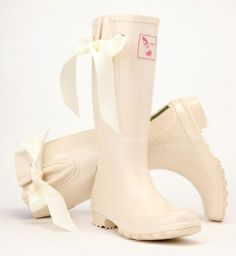 I Do Ribbon Wedding Wellies, Cream.  Famous wedding wellies.  Made from natural rubber. Fuschia Cotton lining. Adjustable gusset. Silk ribbon.  Free humming bird key ring.