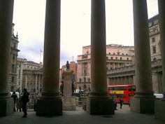 Looking out from behind the columns at the Royal Exchange in the City of London | Europe a la Carte Travel Blog