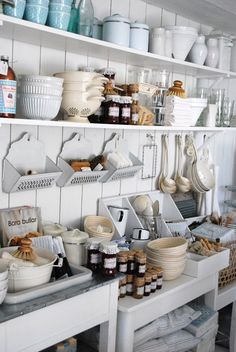 Love the all the open white shelving, cool pantry.