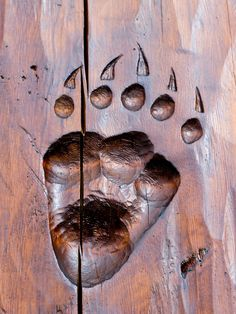 I love this idea! paw print carving