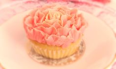 Delicate pink & cream rose blossom cupcake www.designerscupcakes.com