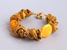 Sunny satin bracelet with glass, ceramic and gold pieces