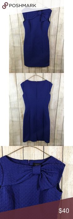 """Tahari Sheath Dress Lovely cobalt blue sheath dress. Textured material with bow detail on front collar. Cap sleeve. Fully lined. Excellent condition. pit to pit: 16"""" length pit to bottom hem: 30"""" Tahari Dresses Midi"""