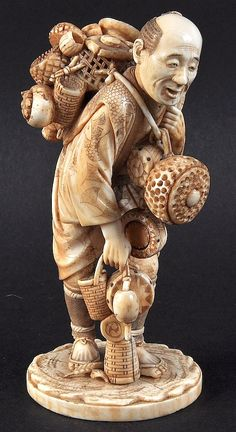 A LATE 19TH CENTURY JAPANESE MEIJI PERIOD IVORY OKIMONO depicting a basket seller with his wares upon his back. Signed. 5.5ins high.