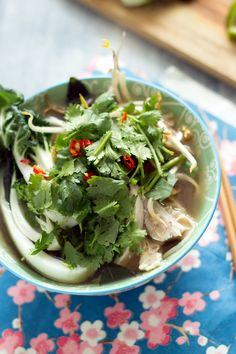 pho ga (vietnamese chicken soup with pak choi and rice noodles)