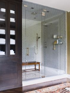 absolutely stunning oversized shower stall with rainfall shower head ... love love love the use of three different tiles on the wall, ceiling, and floor.