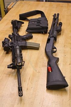 """Bushmaster and Remington 870 Tactical. Like the Mossberg 500 but went with Rem 870 has 18 inch barrel allows for good versatility and agility in tight spaces and in hallways for home defense. is for the question """"How the hell did the worl Remington 870 Tactical, Tactical Shotgun, Tactical Rifles, Firearms, Shotguns, Mossberg 500 Tactical, Tactical Survival, Military Weapons, Weapons Guns"""