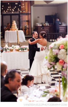 -can see the cake table & bar on elevation at front of room at El Convento  -Vanessa Velez Photography