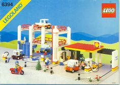 LEGO...! This was one of the biggest structures I had, with my favorite blue/yellow figure on his red motorcycle.