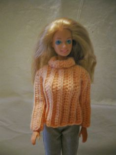 How about a nice comfy sweater for your Barbie.  This is an easy pattern that works up fairly quickly.  You can use a baby/sport weight ...