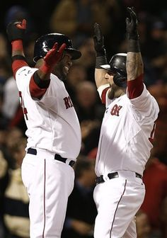 Boston Red Soxs Mike Napoli, right, celebrates his grand slam with teammate David Ortiz during the fifth inning of a baseball game against the Oakland Athletics at Fenway Park in Boston on Monday, April 22, 2013. (AP Photo/Winslow Townson)