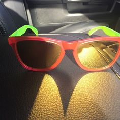 Oakley Frogskins Sunglasses neon pink yellow Oakley Frogskins Sunglasses neon pink yellow. Scratches on the lens shown in photo. Mirrored lenses. Oakley Accessories Sunglasses