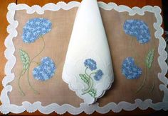 """The eight (8) placemats with sheer white Swiss cotton organdy centers and white Irish linen borders are dinner size at 19"""" long x 13"""" deep. The eight (8) matching dinner size napkins are 17"""" x 17"""". $375 via @MiLady's Vintage Linens. I love hydrangeas."""